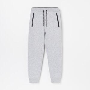 Reserved - Kalhoty joggers skapsami na zip -